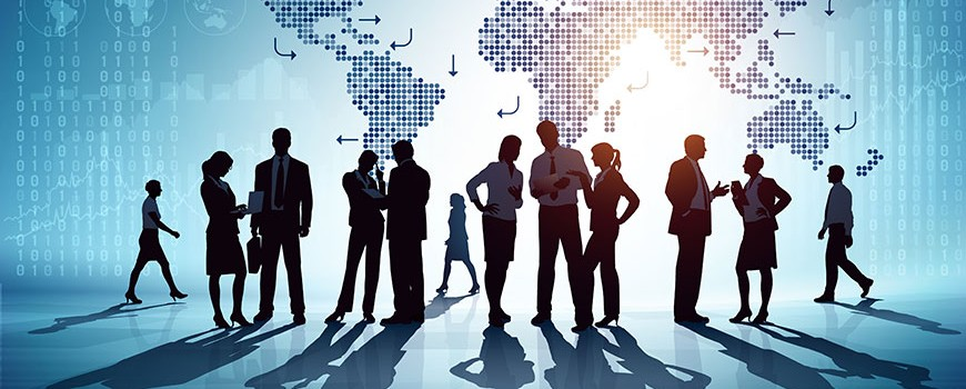 Silhouette of business people standing in front of world map